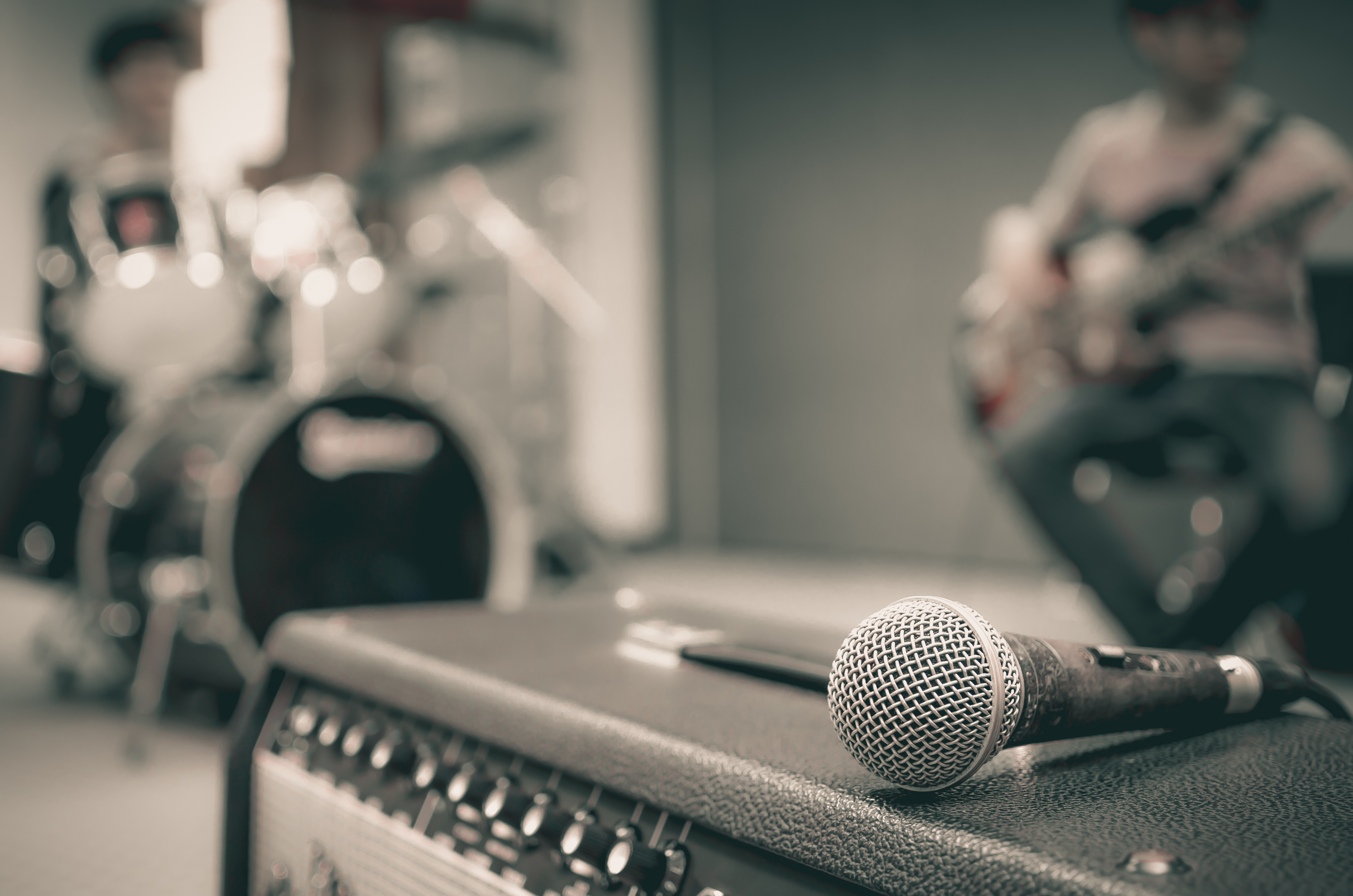 Closeup of microphone on musician blurred background